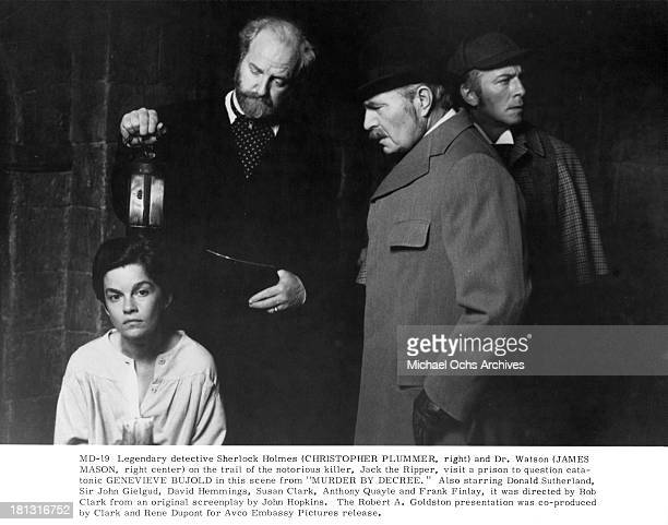 Actress GeneviFve Bujold Actors Anthony Quayle Christopher Plummer and James Mason on set of the movie Murder by Decree in 1979