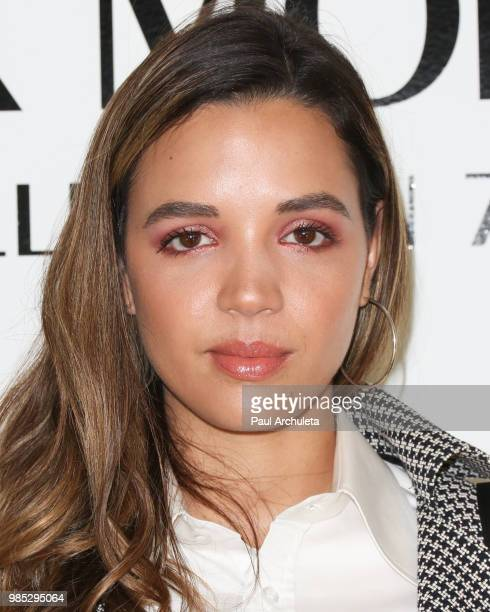 Actress Georgie Flores attends the Wolk Morais collection 7 fashion show at The Jeremy Hotel on June 26 2018 in West Hollywood California