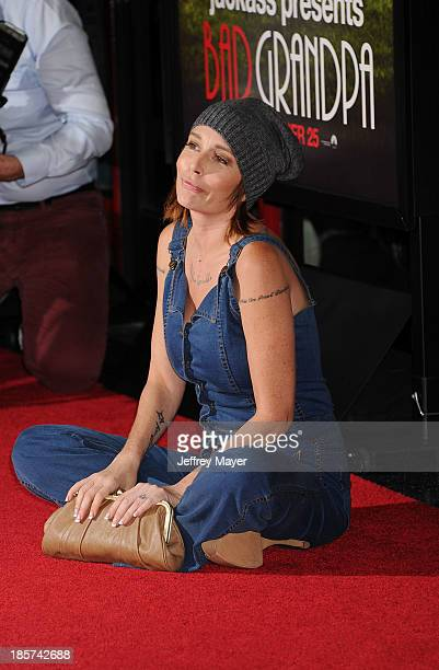 Actress Georgina Cates arrives at the Los Angeles premiere of 'Jackass Presents Bad Grandpa' at TCL Chinese Theatre on October 23 2013 in Hollywood...