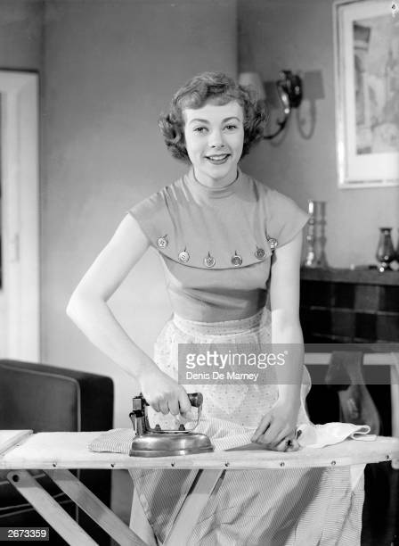Actress Geraldine McEwan ironing clothes during a performance of 'For Better For Worse' at London's Comedy Theatre