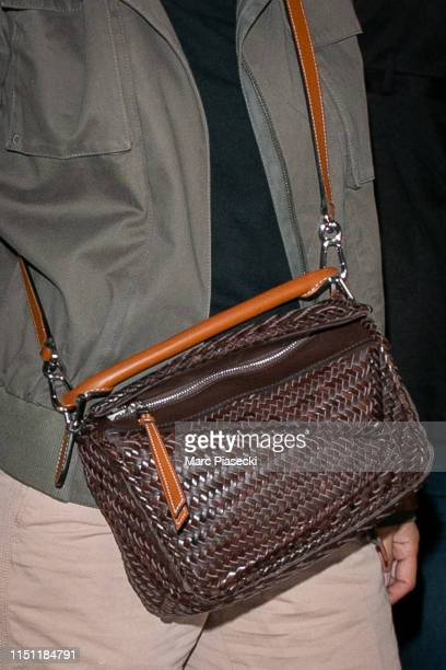 Actress Geraldine Nakache handbag detail arrives ahead the 72nd annual Cannes Film Festival at Nice Airport on May 23 2019 in Nice France