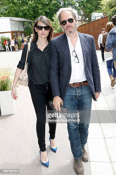 Actress Geraldine Pailhas and husband Christopher Thompson attend Roland Garros Tennis French Open 2013 Day 7 on June 1 2013 in Paris France