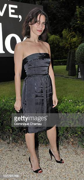 Actress Geraldine Pailhas poses as she arrives at the Chloe new Fragance Launch at the Apicius restaurant in Paris on June 16 2010 in Paris France