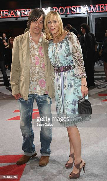 Actress Gesine Cukrowski and friend Michael Helfrich attend the German premiere of Inglourious Basterds on July 28 2009 in Berlin Germany