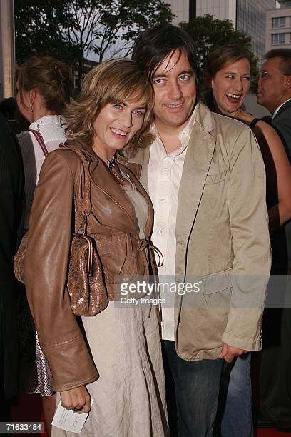 Actress Gesine Cukrowski and Michael Helfrich attend the premiere of the play Die Dreigroschenoper at the Admiralspalast on August 11 2006 in Berlin...