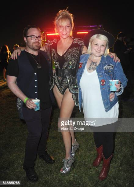 Actress Gigi Edgley of 'Farscape' poses with Getty Geek's Paul Butterfield and Angela Papuga at Stan Lee 95th Birthday House Party held at Private...