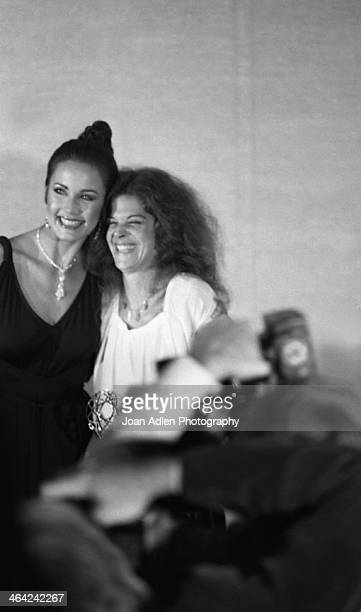 Actress Gilda Radner poses with presenter Lynda Carter after winning Best Supporting Actress in Variety or Music For 'Saturday Night Live' at the...