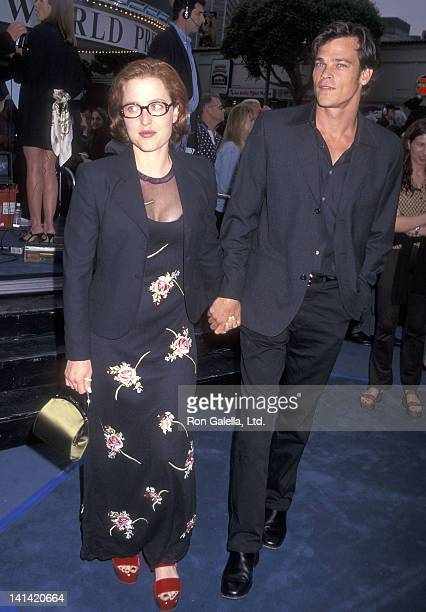 Actress Gillian Anderson and actor Rodney Rowland attend the Batman Robin Westwood Premiere on June 12 1997 at Mann Village Bruin Theatres in...