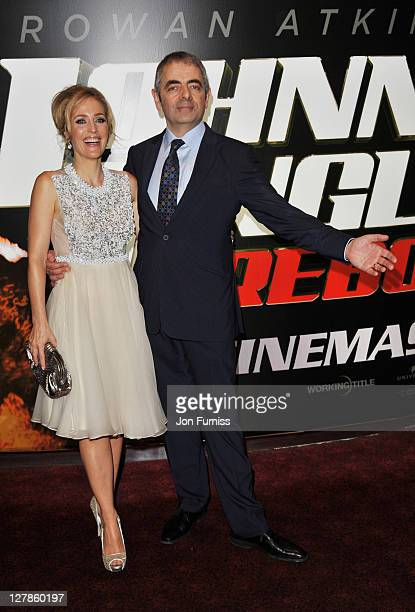 """Actress Gillian Anderson and actor Rowan Atkinson attend the """"Johnny English Reborn"""" UK premiere at Empire Leicester Square on October 2, 2011 in..."""