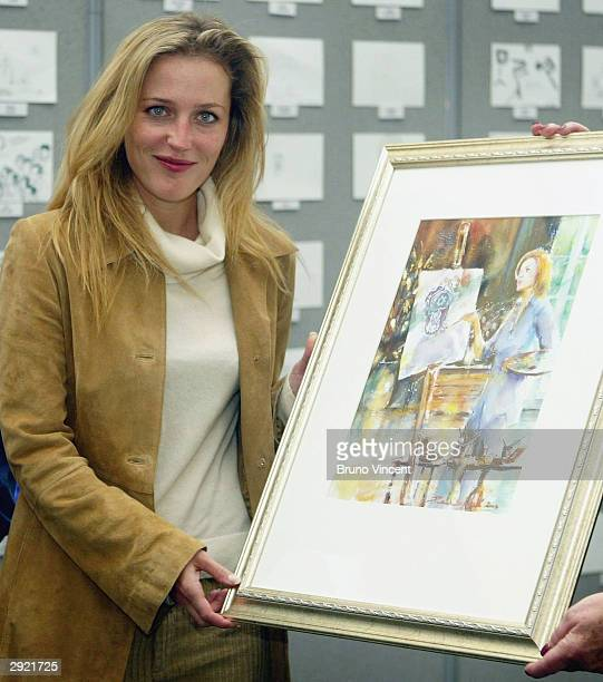 Actress Gillian Anderson attends a photocall to mark National Doodle Day at the Jerwood Space on February 2 2004 in London The event hopes to raise...