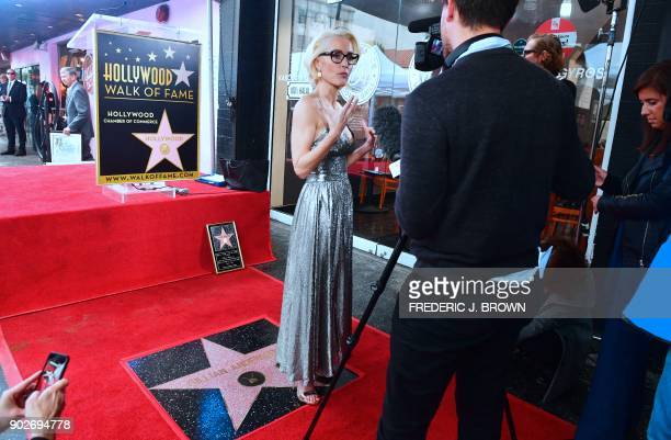 Actress Gillian Anderson is interviewed beside her Hollywood Walk of Fame Star in Hollywood California on January 8 2018 She was the recipient of the...