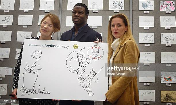 Actress Gillian Anderson Martin Offiah and Glenda Jackson attend a photocall to mark National Doodle Day at the Jerwood Space on February 2 2004 in...