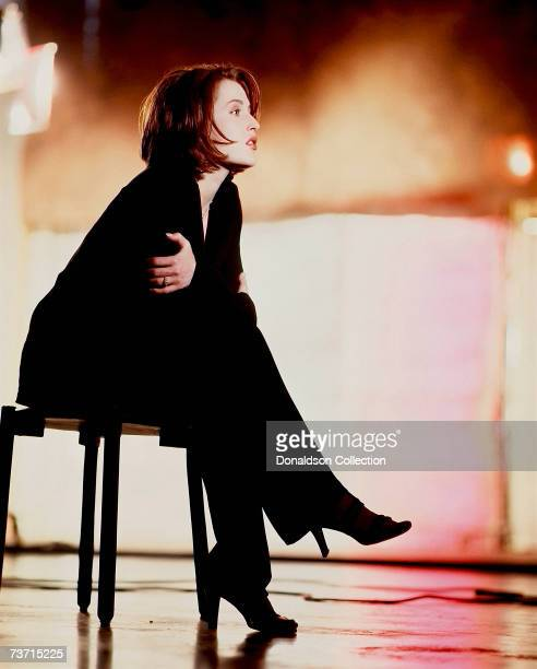 Actress Gillian Anderson poses during a photo shoot for TV Guide in 1998 at a studio in Vancouver Canada