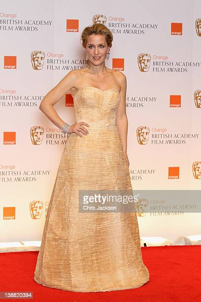 Actress Gillian Anderson poses in the press room during the Orange British Academy Film Awards 2012 at the Royal Opera House on February 12 2012 in...