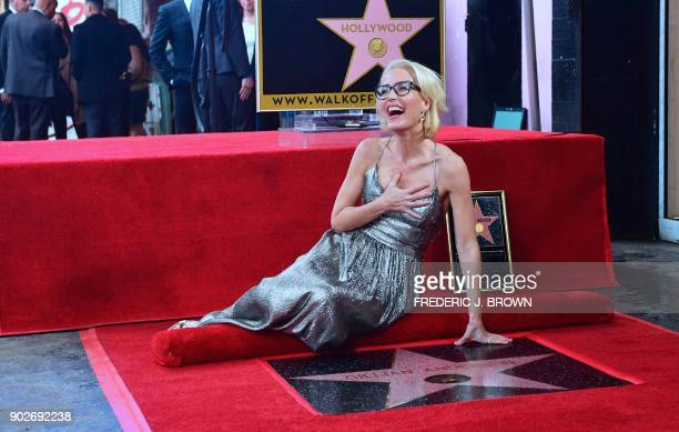 Actress Gillian Anderson poses on her Hollywood Walk of Fame Star in Hollywood California on January 8 2018 She was the recipient of the 2625th Star...