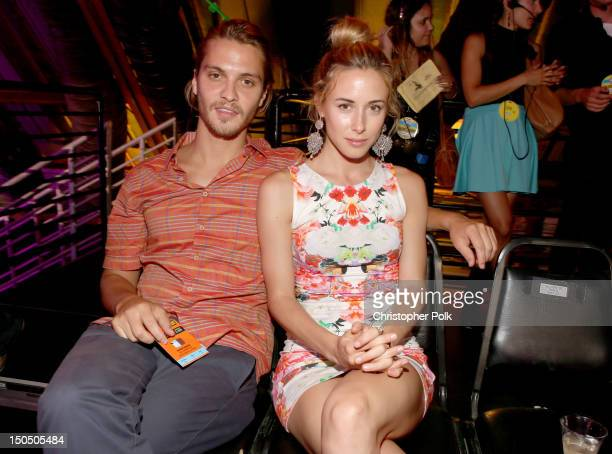 Actress Gillian Zinser and actor Luke Grimes attend the 2012 Do Something Awards at Barker Hangar on August 19 2012 in Santa Monica California