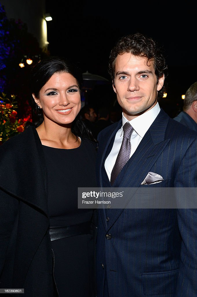 Actress Gina Carano (L) and Henry Cavill attend the GREAT British Film Reception at British Consul General's Residence on February 22, 2013 in Los Angeles, California.