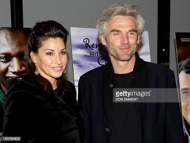 Actress Gina Gershon and her boyfriend Bobby Kaiser pose for a photo before a screening of The Intouchables March 1 2012 at Lincoln Center in New...