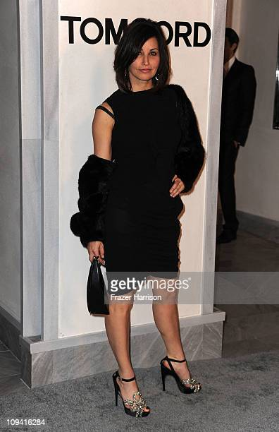 Actress Gina Gershon arrives at the Tom Ford Beverly Hills Flagship Store Opening on Rodeo Drive on February 24 2011 in Beverly Hills California