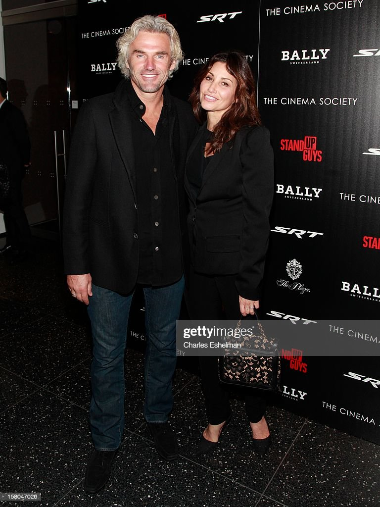 Actress Gina Gershon (R) attends The Cinema Society With Chrysler & Bally Host The Premiere Of 'Stand Up Guys' at The Museum of Modern Art on December 9, 2012 in New York City.