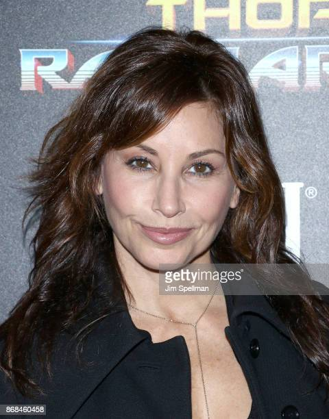 Actress Gina Gershon attends the screening of Marvel Studios' 'Thor Ragnarok' hosted by The Cinema Society with FIJI Water Men's Journal and...