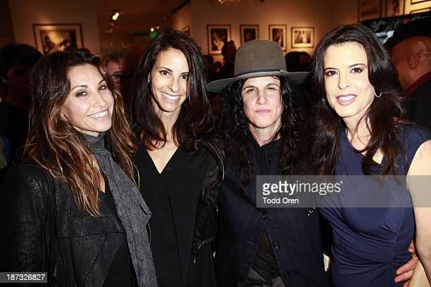 Actress Gina Gershon Joyce Varvatos photographer Amanda Demme and guest attend the 'John Varvatos Rock In Fashion book launch celebration held at...