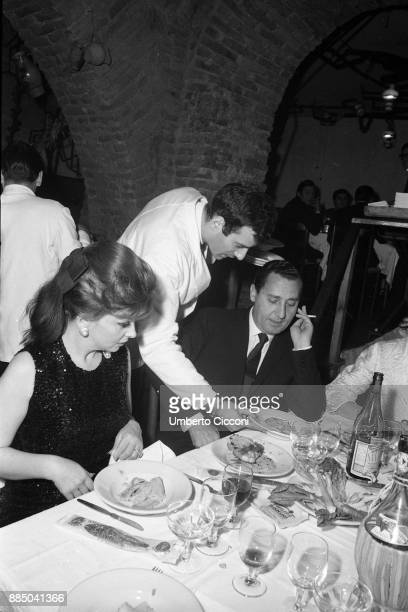 Actress Gina Lollobrigida and actor Alberto Sordi at the restaurant with friends Rome 1967