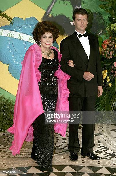 Actress Gina Lollobrigida and Javier Rigau Rifols arrive at the Rose Ball 2005 at The Sporting Monte Carlo on March 19 2005 in Monte Carlo Monaco