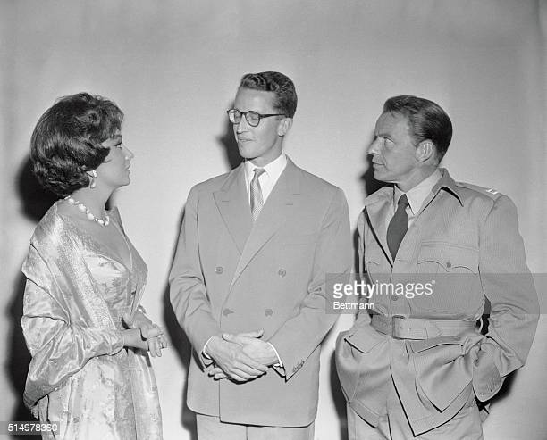 Actress Gina Lollobrigida in Bulgari jewellery and actor Frank Sinatra chat here with King Baudouin of Belgium during the young Monarch's two hour of...