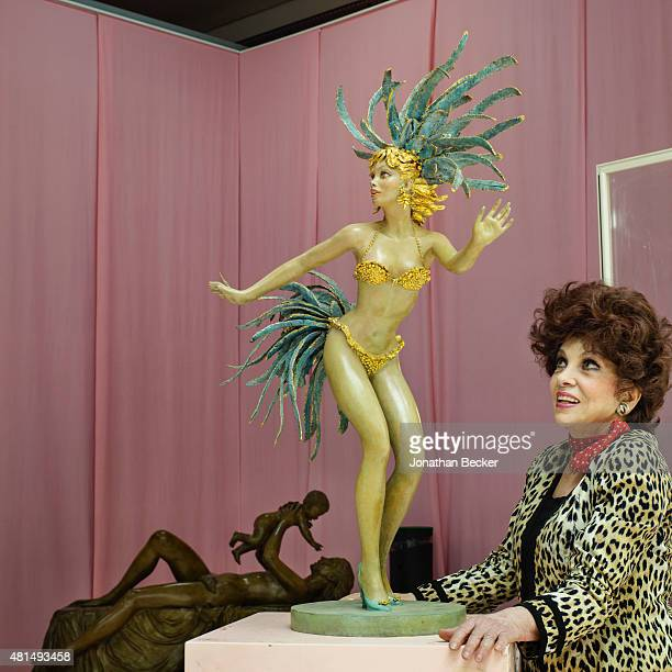 Actress Gina Lollobrigida is photographed with her sculptures for Vanity Fair Magazine on May 24 2014 in her studio in Pietrasanta Italy Gina poses...