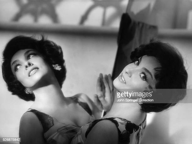 Actress Gina Lollobrigida Leaning on a Mirror