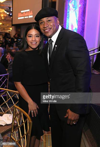 Actress Gina Rodriguez and host LL Cool J attend the Venice Family Clinic's Silver Circle Gala at Regent Beverly Wilshire Hotel on March 9 2015 in...