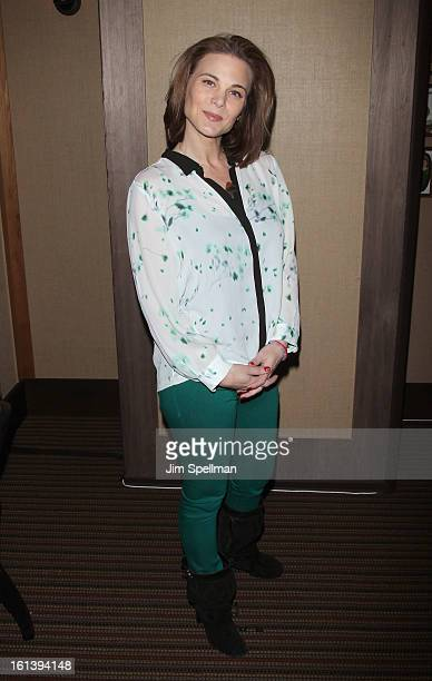 Actress Gina Tognoni attends the Spontaneous Construction premiere at Guys American Kitchen Bar on February 10 2013 in New York City