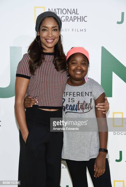 Actress Gina Torres and her daughter Delilah Fishburne arrive at the premiere of National Geographic Documentary Films' Jane at the Hollywood Bowl on...