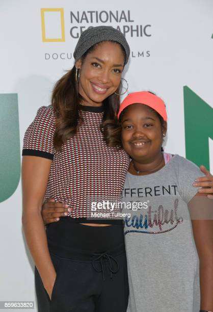 Actress Gina Torres and her daughter Delilah Fishburne arrive at the premiere of National Geographic Documentary Films' 'Jane' at the Hollywood Bowl...
