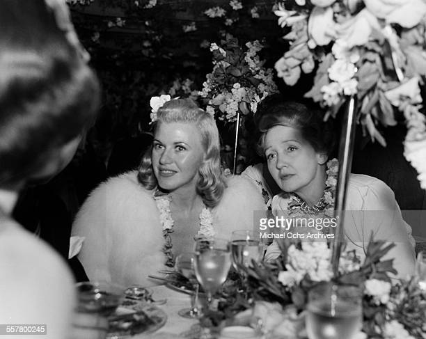 Actress Ginger Rogers and gossip columnist Hedda Hopper attend an event in Los Angeles California