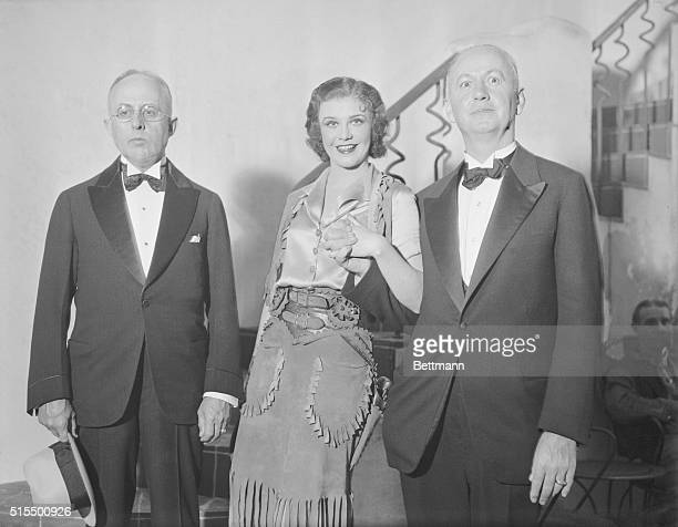 Actress Ginger Rogers at the Alvin Theatre with Kansas City mayor Bryce B. Smith and St. Louis mayor Victor J. Miller. A friendly controversy is...