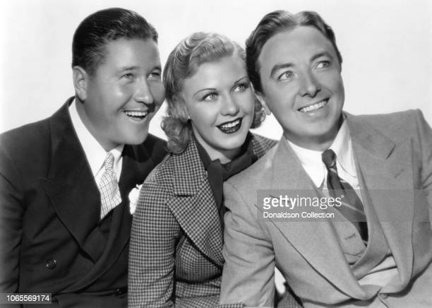 Actress Ginger Rogers Jack Oakie and Jack Haley in a scene from the movie Sitting Pretty