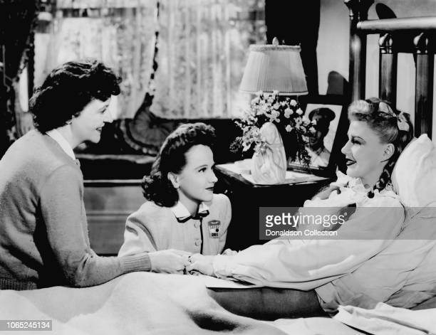Actress Ginger Rogers with Patricia Collinge and Kim Hunter in a scene from the movie Tender Comrade