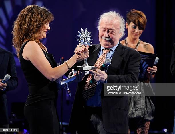 Actress Giovanna Mezzogiorno gives the 'Vittorio Mezzogiorno Award' to Gianni Mina during the Giffoni Experience 2010 on July 25 2010 in Giffoni...
