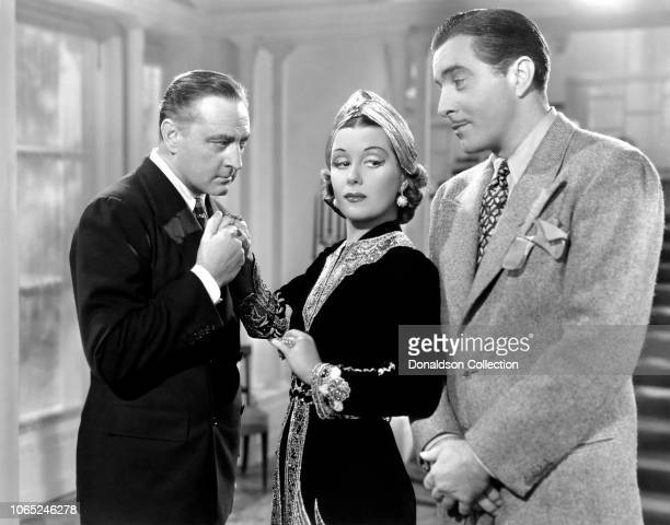 Actress Gladys Swarthout John Boles John Barrymore in a scene from the movie Romance in the Dark