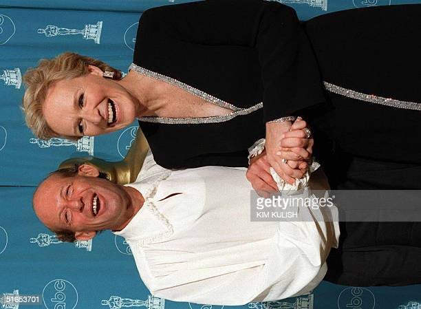 Actress Glenn Close and Australian pianist David Helfgott whose life was portrayed by Oscarnominated actor Geoffrey Rush in the film Shine pose for...