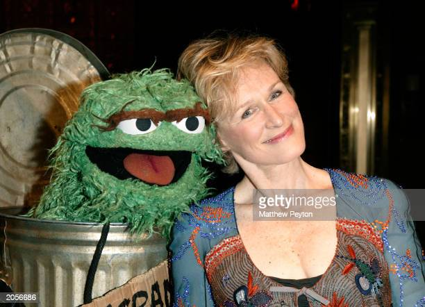 Actress Glenn Close and Muppet Oscar the Grouch attend the Sesame Street Workshop 35th Anniversary Gala at Cipriani June 4 2003 in New York City