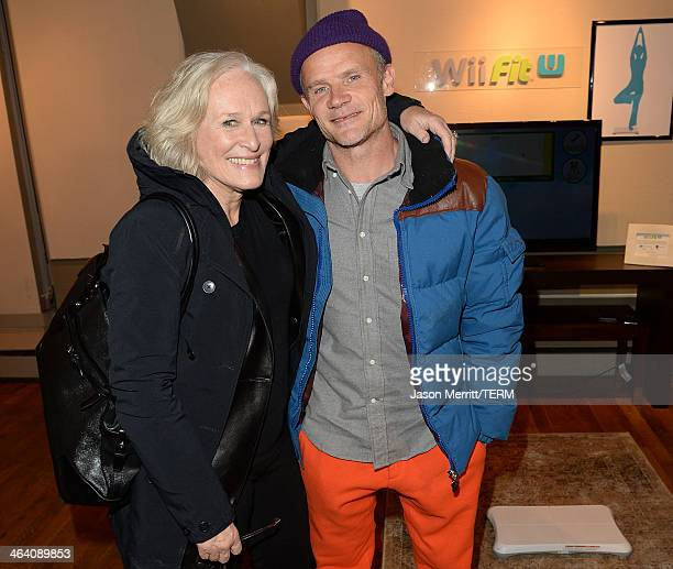 Actress Glenn Close and recording artist Flea pose for a picture while Wii Fit U Brings Fun and Fitness to the Nintendo Chalet during the 2014...