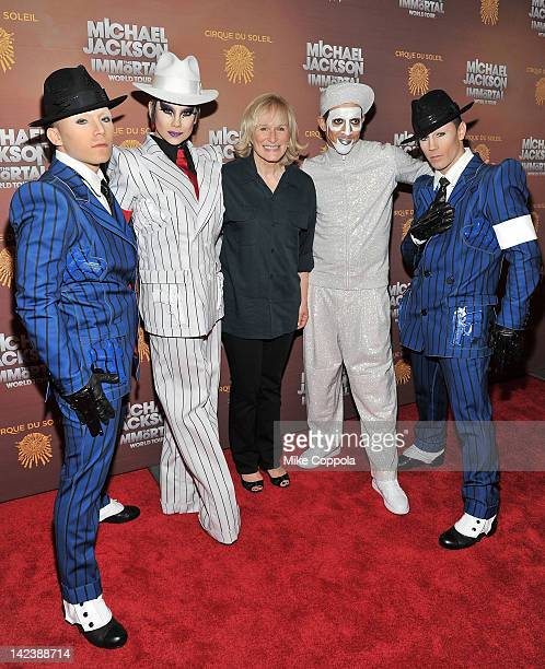 Actress Glenn Close poses for a picture with cirque du soleil cast members for Michael Jackson the Immortal World Tour of at Madison Square Garden on...