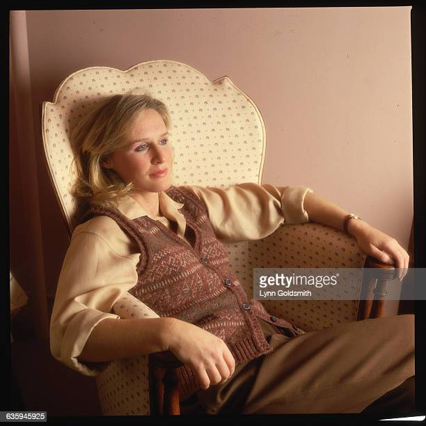 Actress Glenn Close relaxes in a chair apparently deep in thought