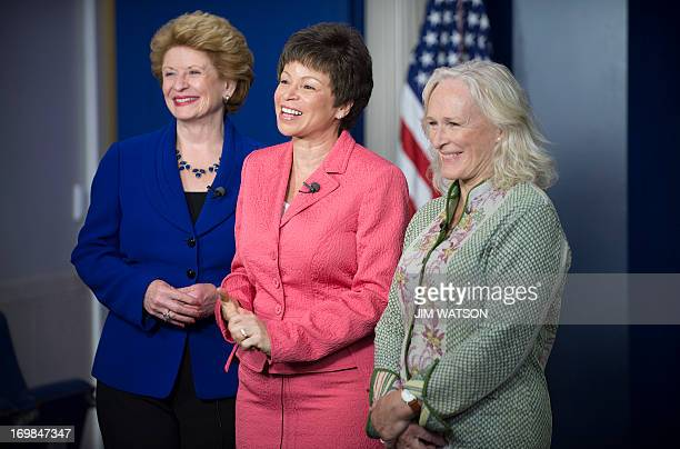 Actress Glenn Close stands with White House Senior Advisor Valerie Jarett and US Senator Debbie Stabenow DMichigan at the White House where she will...