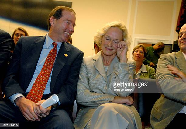 Actress Glenn Close wipes a tear from her eye alongside Rep Tom Udall DNM after she recalled a beautiful elephant scene she observed on a recent trip...