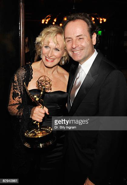 """Actress Glenn Close , with her Emmy award for Best Actress in a Drama Series, and FX Network President John Landgraf arrive at the """"Damages"""" post..."""