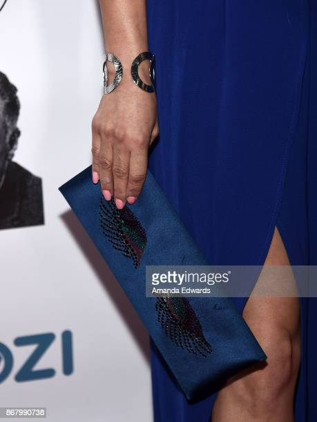Actress Gloria Garayua clutch and bracelet detail arrives at the 3rd Annual Carney Awards at The Broad Stage on October 29 2017 in Santa Monica...